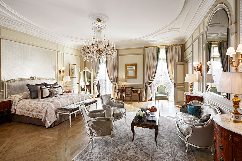 The bedroom of the presidential suite at Le Meurice is decorated for royalty